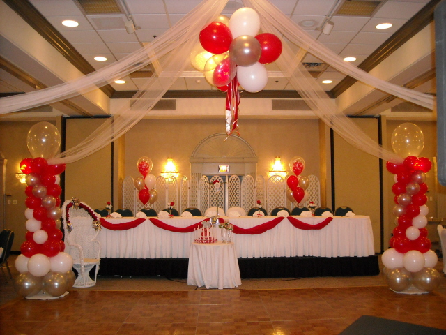 center topiary name arch amp head table